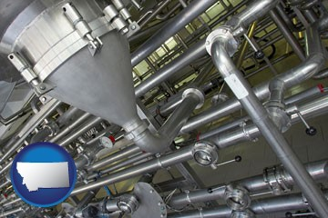 an industrial, stainless steel piping system - with Montana icon