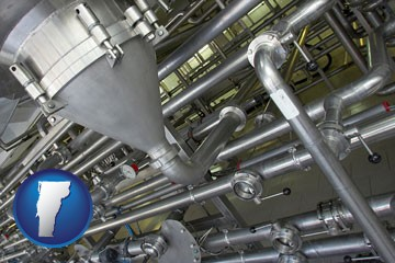 an industrial, stainless steel piping system - with Vermont icon